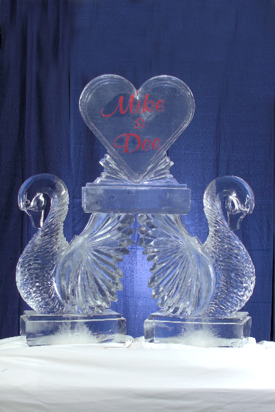 Double Swans Holding a Heart